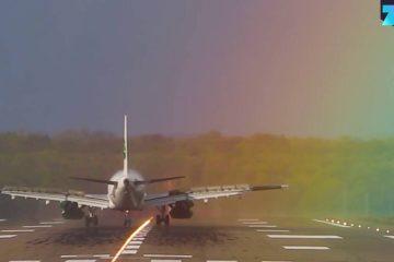 Flugzeug landet im Regenbogen